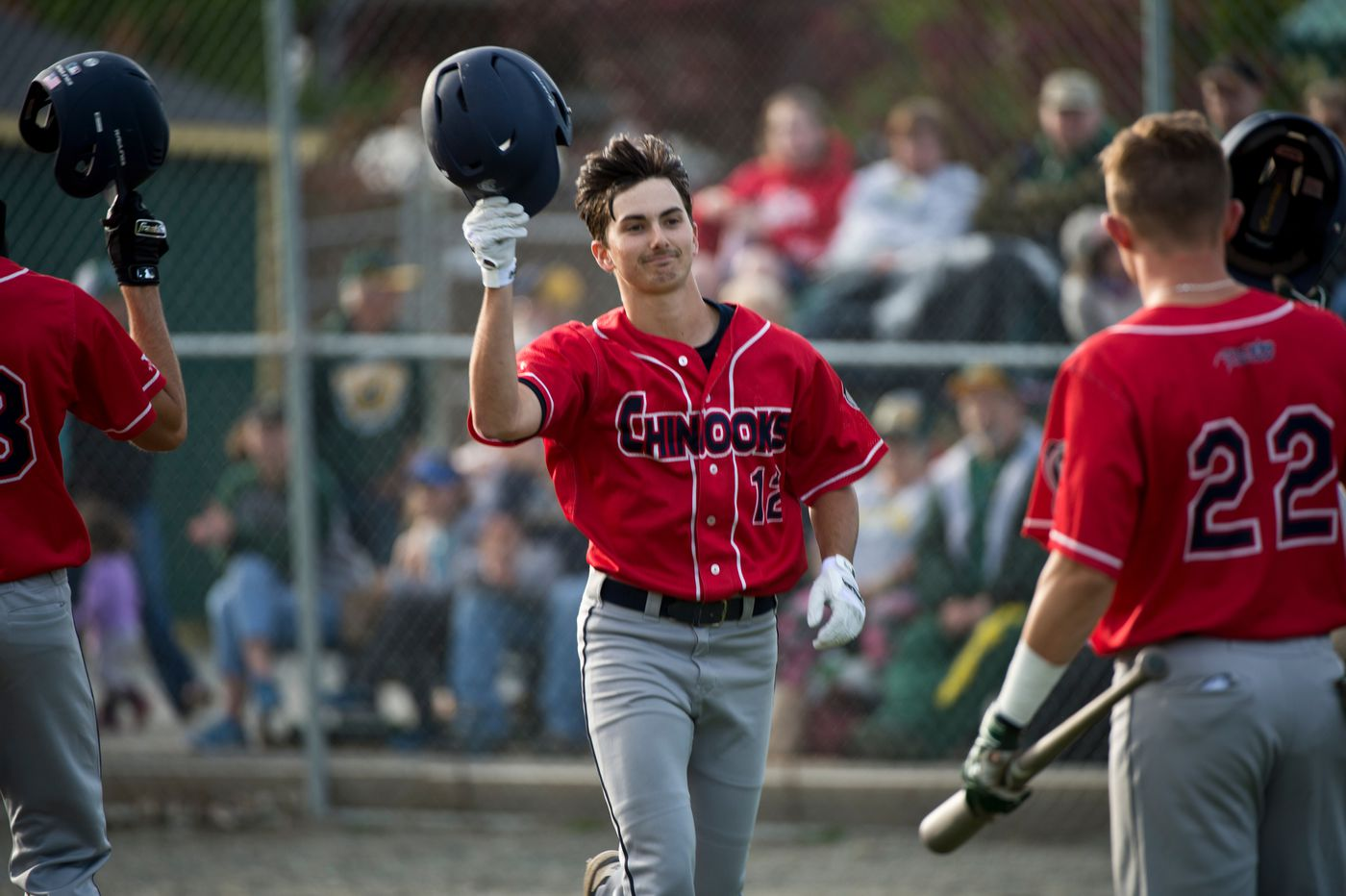 Chinooks batter Haden Keller is greeted by teammates after he hit the ABL season's first home run. (Marc Lester / ADN)