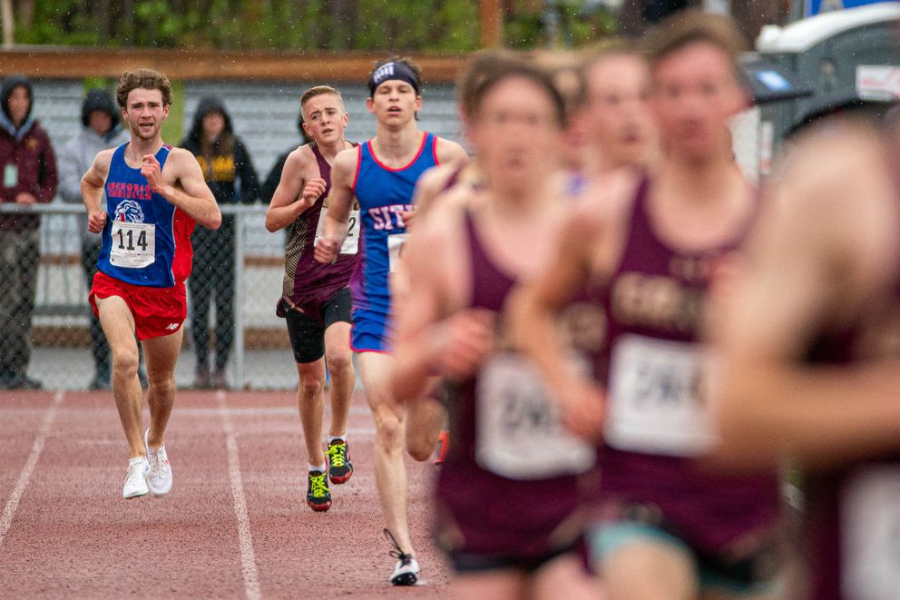 Tristian Merchant laps a few runners on his way to a state record. He was one of 16 boys in the race and he lapped all but one of the others. (Loren Holmes / ADN)
