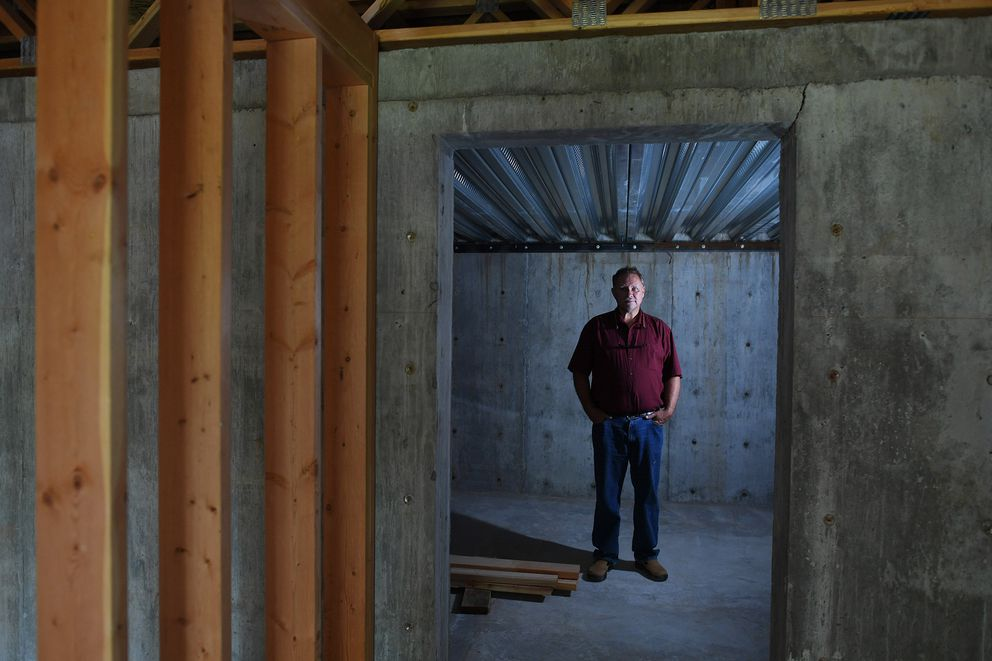 Chris Walsh of Revolutionary Realty stands in the cellar of an unfinished home for sale in Spirit Lake, Idaho. (Matt McClain, The Washington Post)