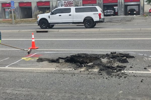 Two lanes of Fifth Avenue closed Thursday, May 27, 2021 when a sinkhole was reported. It was not immediately clear when the lanes would reopen. (Tess Williams / ADN)