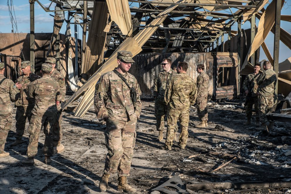 U.S. officials stand near an installation damaged by Iranian airstrikes inside the Ain al-Asad base near Anbar, Iraq, on Jan. 13, 2019. MUST CREDIT: Photo for The Washington Post by Emilienne Malfatto