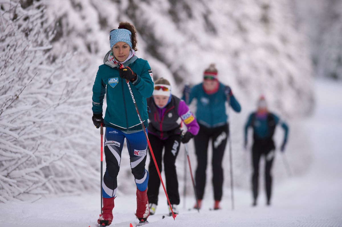 2020 Olympic skier Rosie Frankowski leads a line of skiers on the Gasline Trail last Monday during an APU training session. (Marc Lester / ADN)