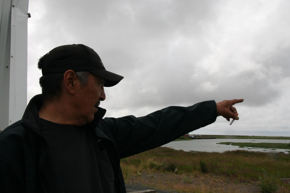 Warren Jones, president of the Quinhagak village corporation Qanirtuuq Inc., on Friday, July 22, 2016, points to where 200 boats would be fishing in front of his Southwest Alaska village during a normal year. But this year commercial fishing is shut down. (Lisa Demer / Alaska Dispatch News)