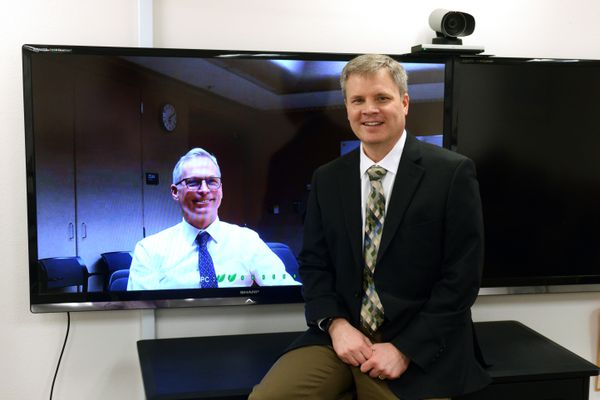President of the University of Alaska Jim Johnsen, left, appears via video feed with Michael Johnson, Commissioner of Education and Early Development, on Friday, Jan. 13, 2017, in Anchorage. (Erik Hill / Alaska Dispatch News)