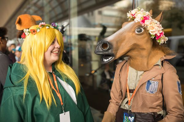 Lidia Smestad, left, dressed as Krista from League of Legends, and Hayate Mayer, as Jean from the same game, wait in line to enter Senshi Con at the Egan Center on Saturday, Oct. 1, 2016. The annual convention celebrates Asian culture, animation, graphic novels and games. (Loren Holmes / Alaska Dispatch News)