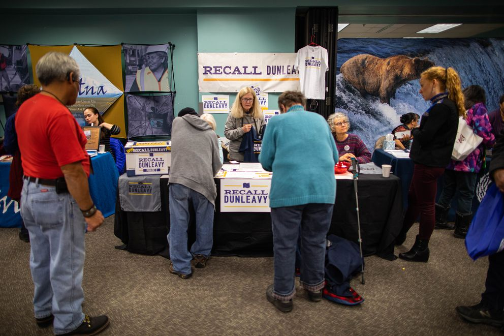 A booth supporting the Recall Dunleavy campaign is manned Friday during the AFN convention in Fairbanks. (Loren Holmes / ADN)