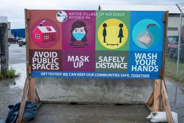 A sign encourages COVID-19 safety precautions on Tuesday, July 20, 2021 in Kotzebue. (Loren Holmes / ADN)