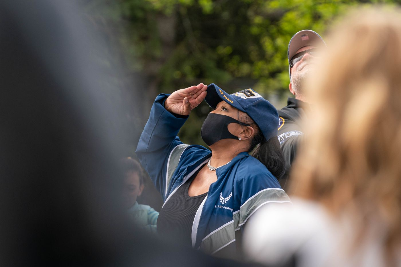 Air Force veteran Louise Williams salutes the flag at the Anchorage Veterans Memorial on Delaney Park Strip on Monday, May 25, 2020 during a Memorial Day observance. (Loren Holmes / ADN)