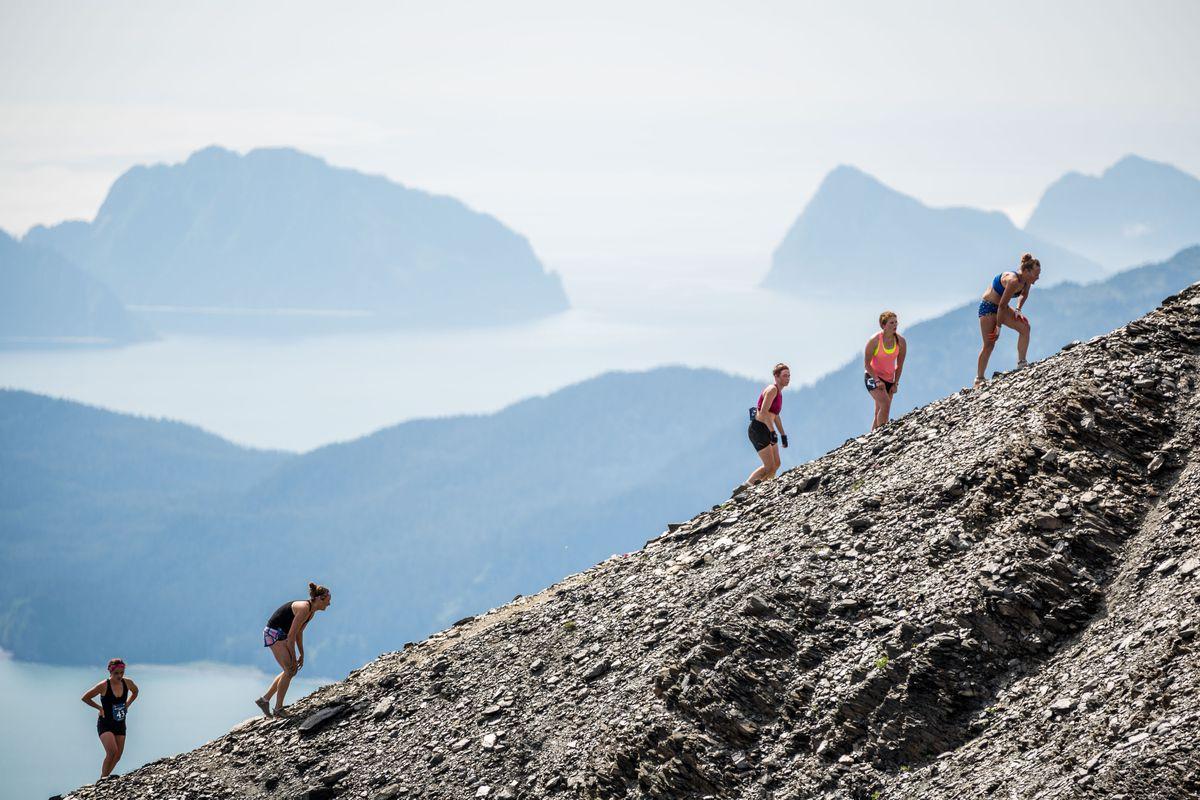 Backdropped by Resurrection Bay, women near the top of Mount Marathon during the 2014 race. (Loren Holmes / Alaska Dispatch News)