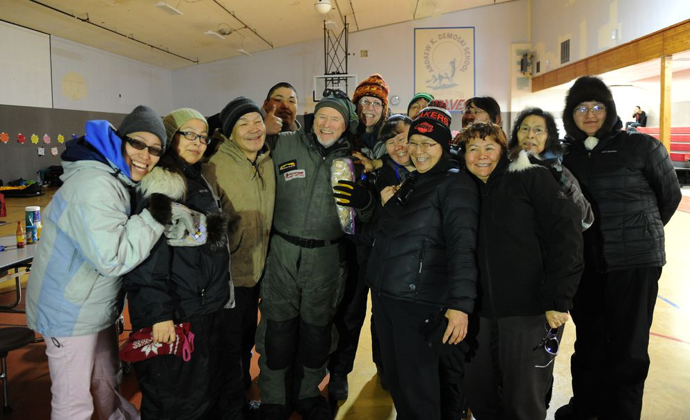 Iditarod musher Jeff King has his picture taken with folks at the village at Nulato, a checkpoint during the 2017 Iditarod Trail Sled Dog Race on Sunday, March 12, 2017. (Bob Hallinen / Alaska Dispatch News)