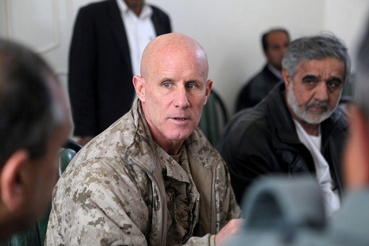 Vice Adm. Robert S. Harward speaks to an Afghan official during his visit to Zaranj, Afghanistan, on Jan. 6, 2011. (Sgt. Shawn Coolman/U.S. Marines/Handout via Reuters)