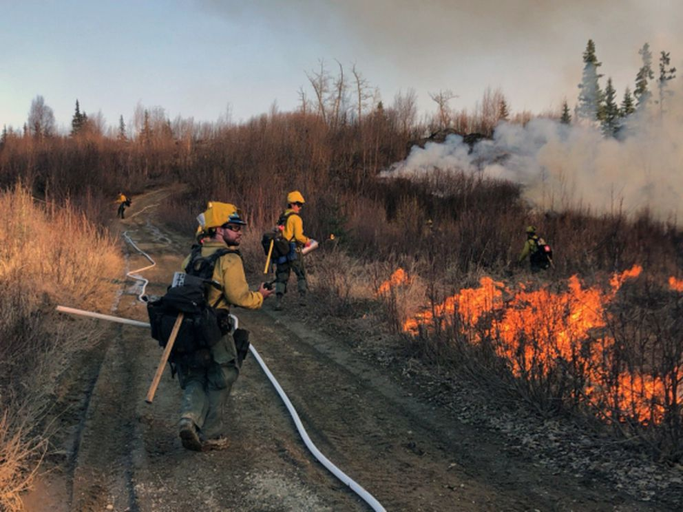 Division of Forestry firefighters conduct a small burnout operation along a four-wheeler trail while fighting the Trumpeter Fire on Wednesday, April 29, 2020. The fire spread across about 120 acres of land between Wasilla and Point MacKenzie. (Bryan Quimby / Alaska Division of Forestry)