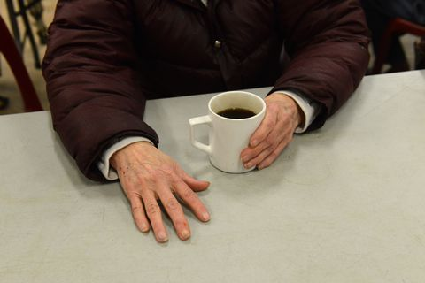 Virginia Cook, 76, who was released to the Brother Francis Homeless shelter from Alaska Psychiatric Institute on November 22, remains homeless Friday, December 15, 2017 as she sips coffee at Bean's Café in Anchorage, Alaska. State officials who control Cook's money have not allowed her to travel to family. (Bob Hallinen /ADN)