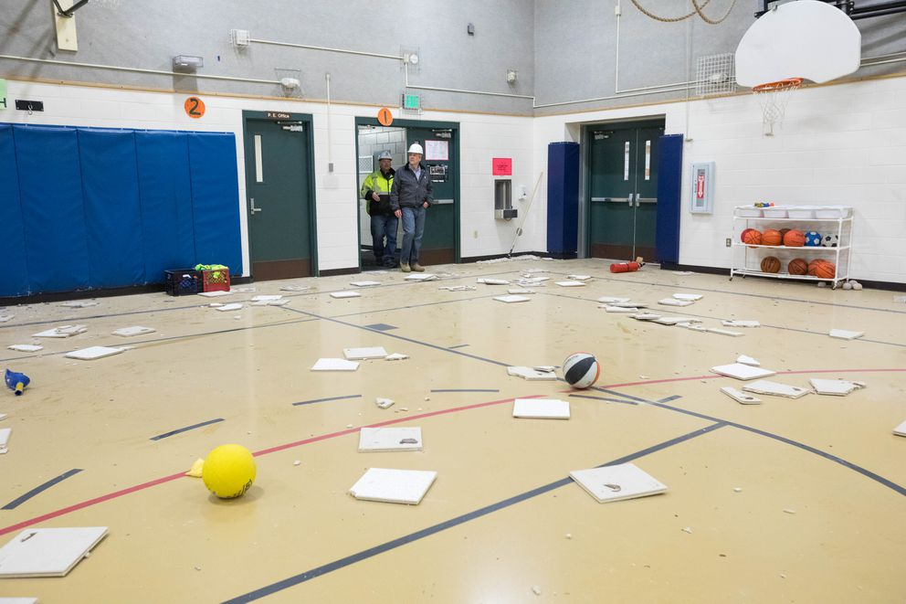 Sen. Dan Sullivan and ASD's Thomas Fenoseff tour the gym at Eagle River Elementary School on Tuesday, Dec. 4, 2018. The school was badly damaged in Friday's 7.0 earthquake, and will remain closed for the remainder of the school year. (Loren Holmes / ADN)