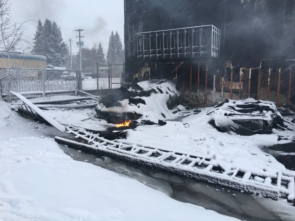 Destroyed vehicles outside the Royal Suite Apartments, where two people died, 16 were injured and dozens were displaced in an early morning fire. (Chris Klint / Alaska Dispatch News)