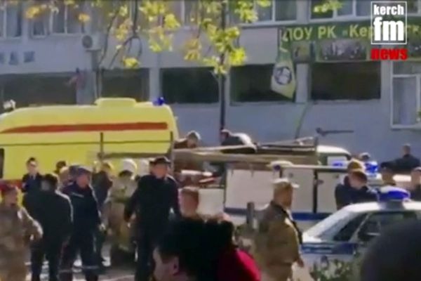 In this image made from video, showing the scene as emergency services load an injured person onto a truck, in Kerch, Crimea, Wednesday Oct. 17, 2018. An explosive device has killed several people and injured at least 50 others at a vocational college in Crimea Wednesday in what Russian officials have called a possible terrorist attack. (Kerch FM News via AP) KERCH.FM LOGO CANNOT BE OBSCURED