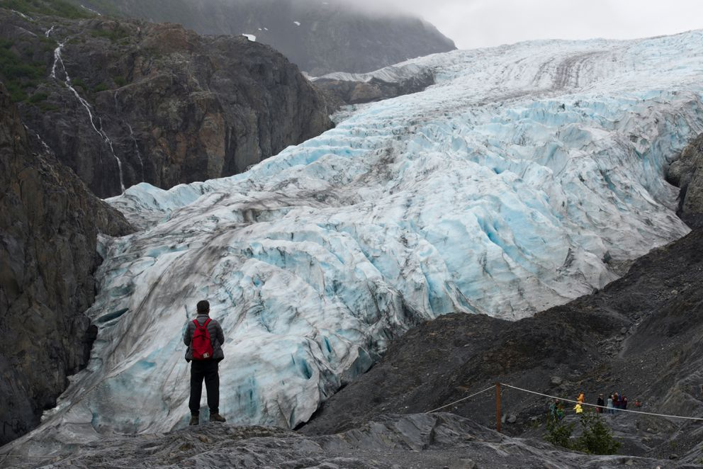 A visitor takes in the view of Exit Glacier in Kenai Fjords National Park on July 17. (Marc Lester / Alaska Dispatch News)