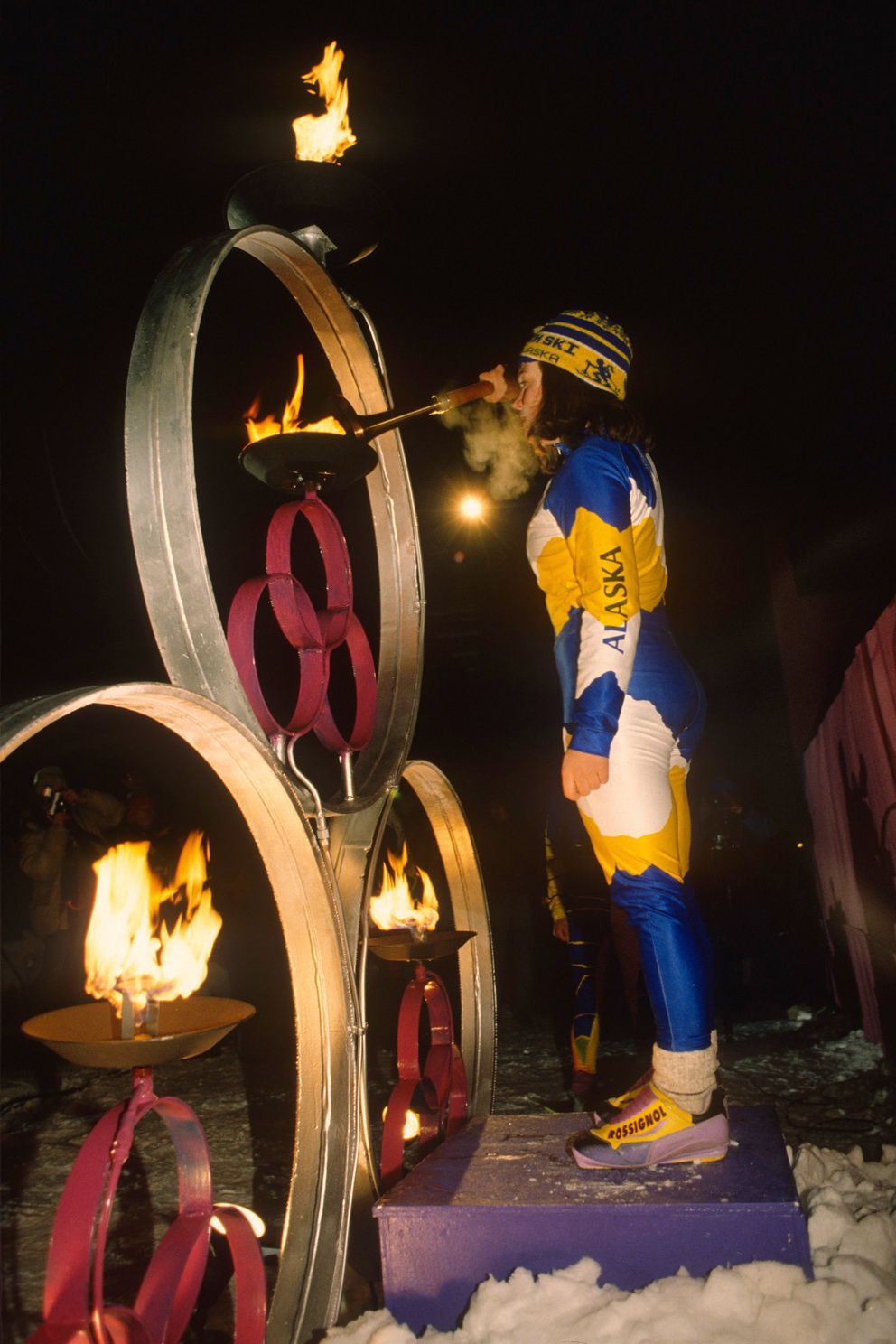 A Team Alaska athlete lights the torch during the opening ceremonies of the 1996 Arctic Winter Games at the Chugiak High. (Bill Roth / ADN archive)
