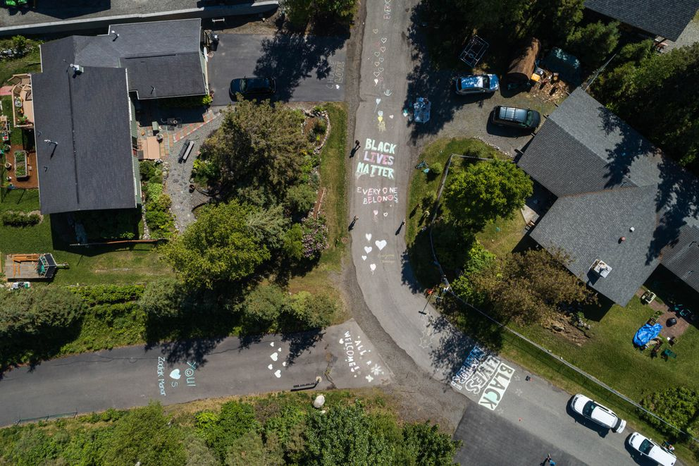 Residents of Zenith Street and the surrounding neighborhood painted welcoming and anti-racist messages on their street on Saturday. (Loren Holmes / ADN)