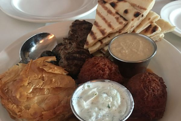 The sampler plate at Aladdin's includes falafel, hummus, tsatsiki, spanakopita, kefta and dolma. (Photo by Mara Severin)