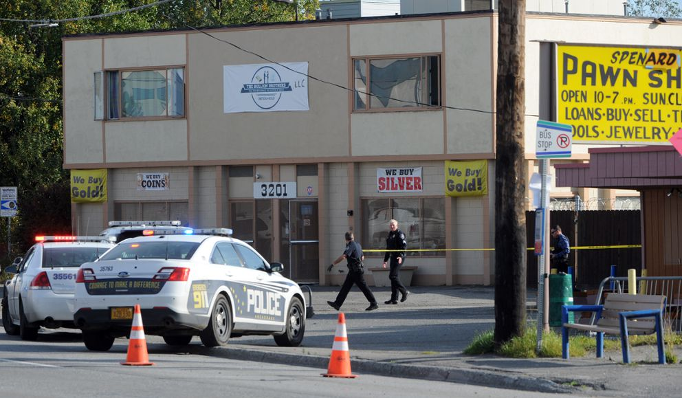 Officers stretch crime scene tape at the shooting scene. (Erik Hill / Alaska Dispatch News)