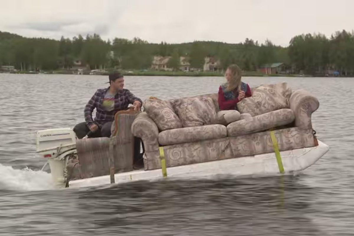 "Cast members on MTV's ""Slednecks"" cruise on a boat made from a couch. (Screen grab from a promotional video released Aug. 24, 2014)"