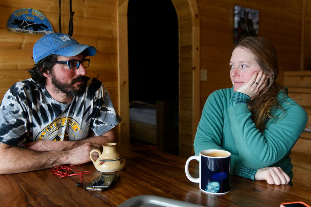 Cody Strathe talks with his wife and fellow distance musher Paige Drobny at their home in Ester on Feb. 13. (Marc Lester / ADN)
