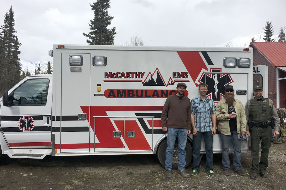 Left to right: Jonathan Dobbs, Jacob Shultz, Randy Samz and Stephens Harper. Dobbs and Samz drove the ambulance from Wisconsin to McCarthy, where they arrived Wednesday to gift the vehicle to the community. Shultz manages the volunteer EMS service in McCarthy and Harper is a National Park Service ranger. (Tamara Harper)