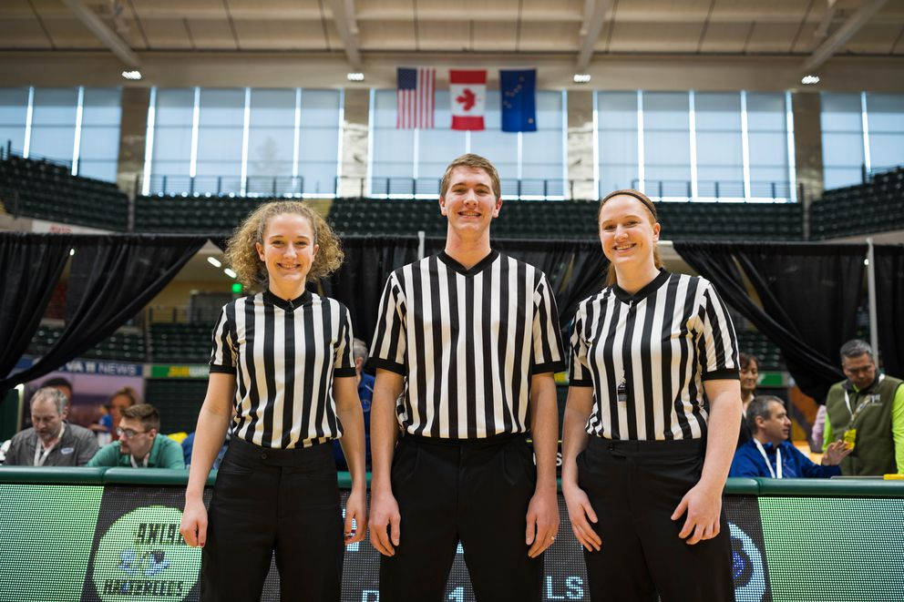 From left, siblings McKenna Dinkel, Graham Dinkel, and Kyla Dinkel pose for a photo before refereeing the 1A/2A Basketball State Championships Wednesday, March 13, 2019 at the Alaska Airlines Center. (Loren Holmes / ADN)