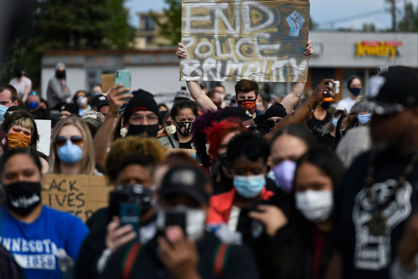 """A crowd gathered in the parking lot of the Midtown Mall Saturday, May 30, 2020, for the """"I Can't Breathe"""" protest against police brutality. (Marc Lester / Anchorage Daily News)"""