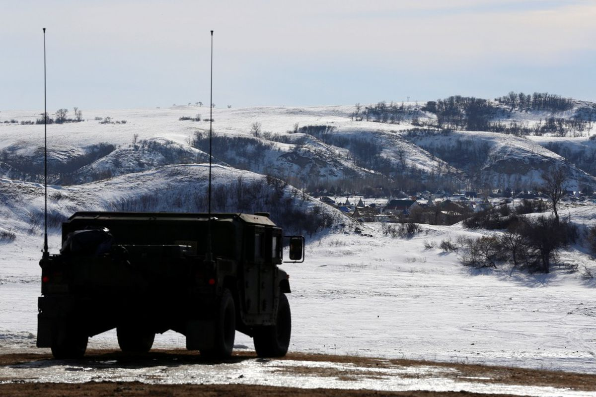 A North Dakota National Guard vehicle idles on the outskirts of the Dakota Access oil pipeline protest camp near Cannon Ball, North Dakota, Jan. 29. REUTERS/Terray Sylvester
