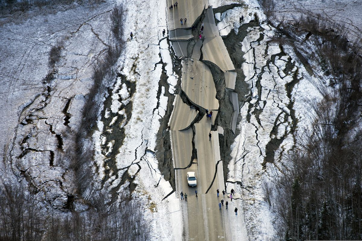 This Nov. 30, 2018 file photo shows a broken and twisted section of Vine Road south of Wasilla following an earthquake. (Marc Lester / ADN)