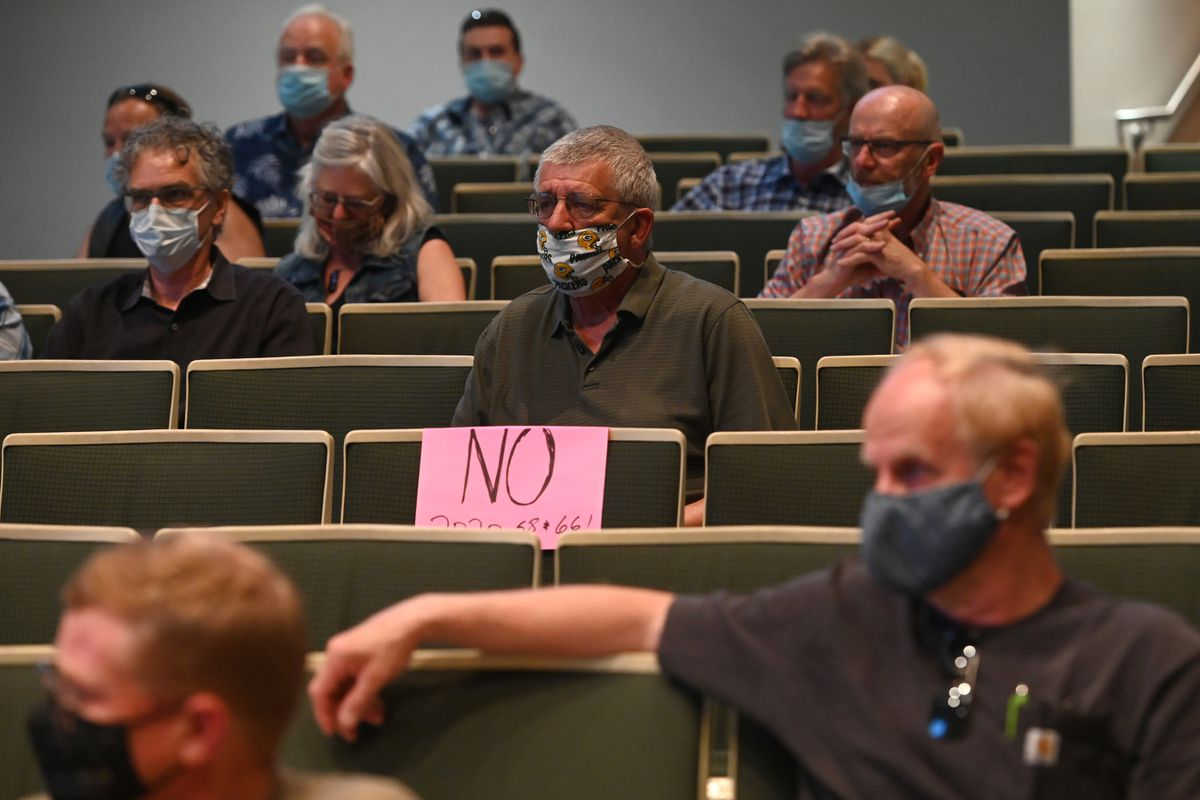 Public attending the Anchorage Assembly meeting on Wednesday, July 15, 2020, wait to testify about the city purchasing buildings for homeless services. (Bill Roth / ADN)