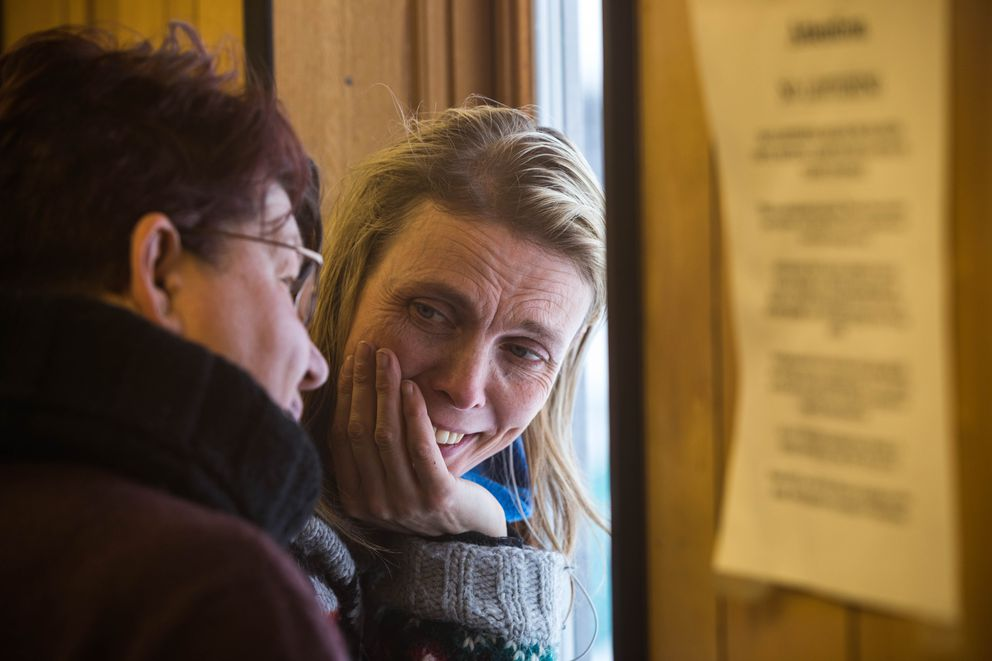 Mille Porsild, Joar Leifseth Ulsom's girlfriend, talks with race judge Karen Ramstead at the White Mountain checkpoint Tuesday. (Loren Holmes / ADN)