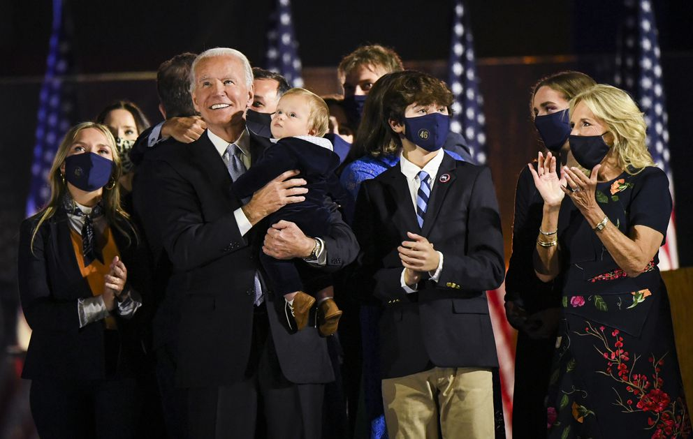 The families of President-elect Joe Biden, with wife Jill Biden, and Vice President-elect Kamala Harris, with husband Doug Emhoff, are pictured following victory speeches in the parking lot of the Chase Center on the Riverfront in Wilmington, Del. on Saturday night. MUST CREDIT: Washington Post photo by Jonathan Newton