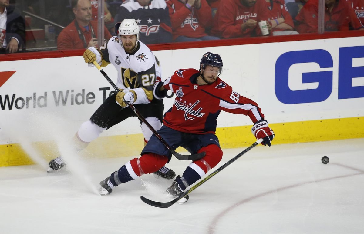 Former UAA skaterJay Beagle (right) skates for the puck against Vegas Golden Knights defenseman Shea Theodore in game four of the Stanley Cup Final. (Amber Searls / USA Today)