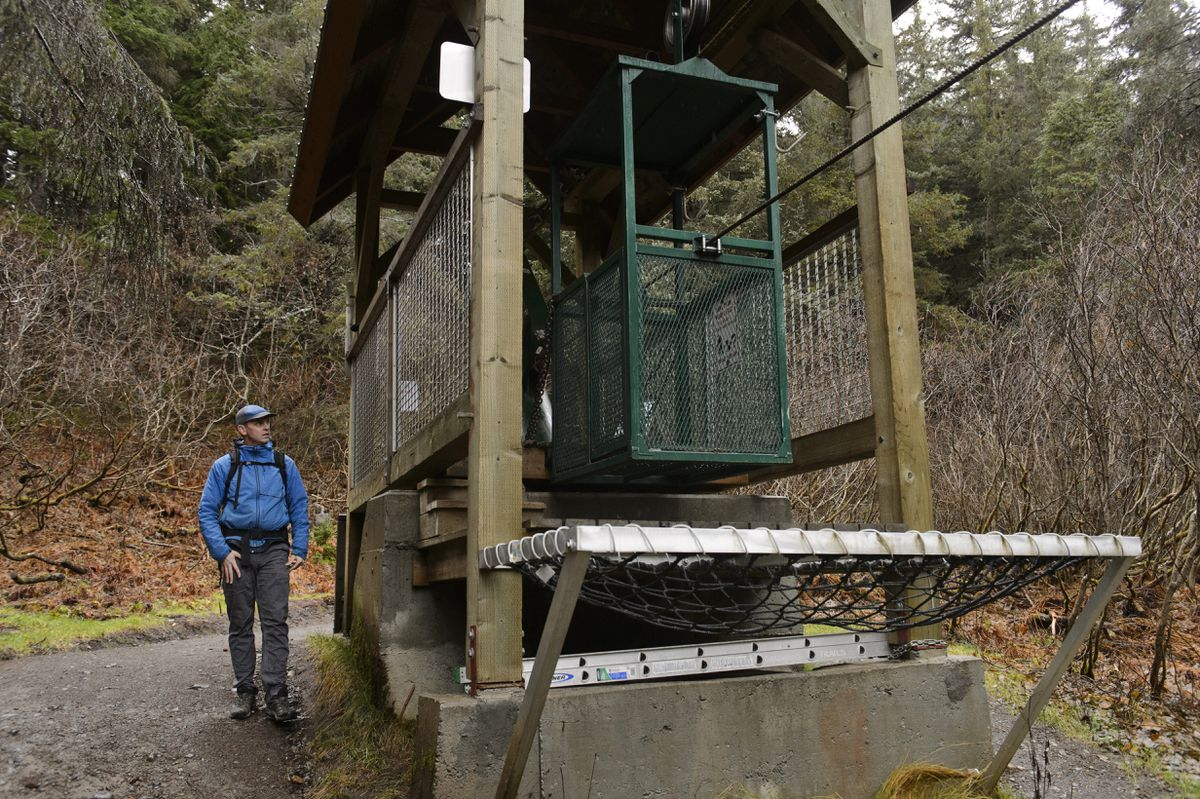 Girdwood Valley Service Area Manager Kyle Kelley is working with the Girdwood Trails Committee to come up with recommendations for the hand tram on the Winner Creek Trail system. (Marc Lester / ADN)