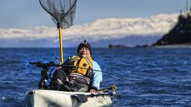 Landing sizable halibut fishing Cook Inlet from a 12-foot kayak