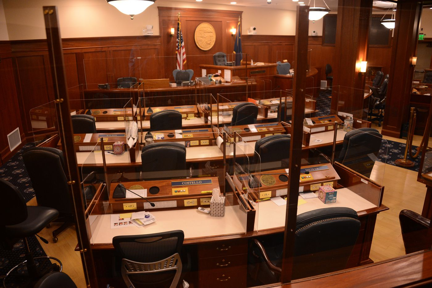 The chambers of the Alaska Senate, seen Monday, Jan. 11, 2021 have been divided with plexiglass shields intended to prevent the spread of COVID-19. (James Brooks / ADN)