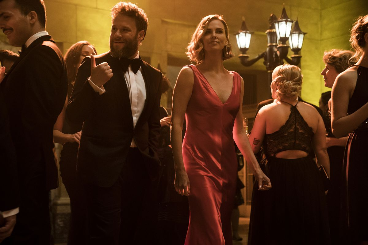 Seth Rogen, left, and Charlize Theron play an unlikely romantic couple in