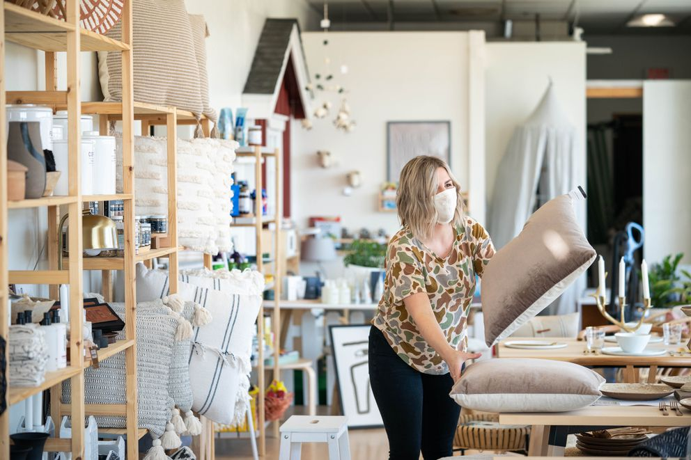 Madora Lester arranges inventory in The Nordic Home on Saturday, April 25, 2020. Shop owner Erika Klaar said she's eyeing a Tuesday reopening for her furniture and home goods store, but is still talking with employees to gauge their comfort level. (Loren Holmes / ADN)