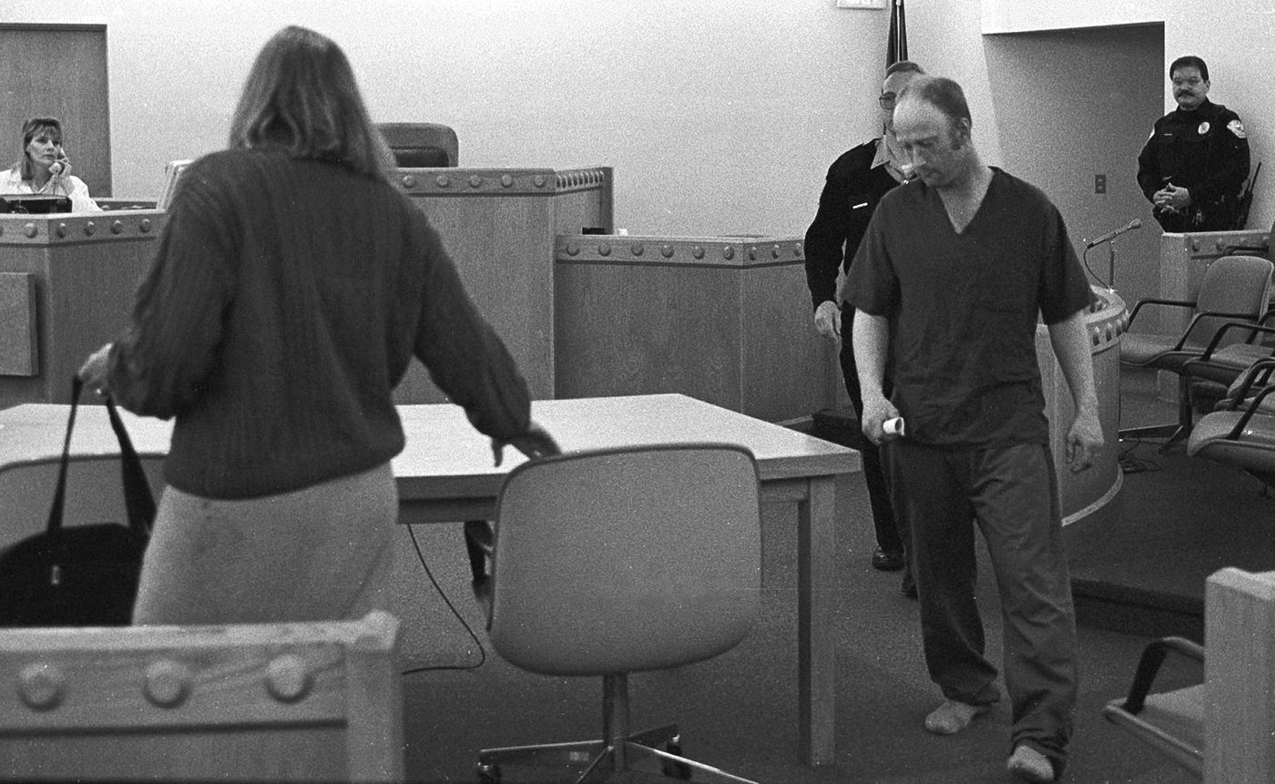Richard Bingham in 1996 in the Sitka Courthouse for his arraignment. At left, with back to camera, is Public Defender Galen Paine. (Daily Sitka Sentinel file photo by Reber Stein)