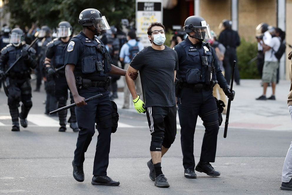 A demonstrator is detained by police during a protest over the death of George Floyd, Monday, June 1, 2020, near the White House in Washington. Floyd died after being restrained by Minneapolis police officers. (AP Photo/Alex Brandon)