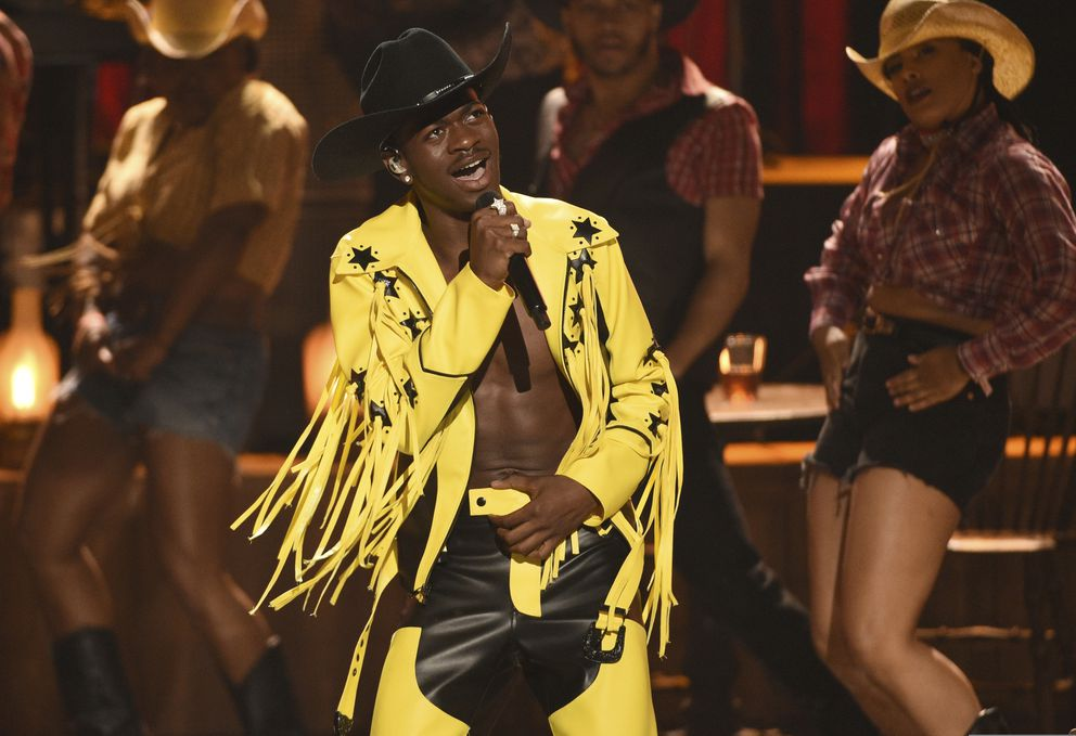 "FILE - This June 23, 2019 file photo shows Lil Nas X performing 'Old Town Road ' at the BET Awards in Los Angeles. The rapper has earned six Grammy Award nominations, Wednesday, Nov. 20, including one for best new artist, album and record of the year for ""Old Town Road,"" featuring Billy Ray Cyrus. (Photo by Chris Pizzello/Invision/AP, File)"