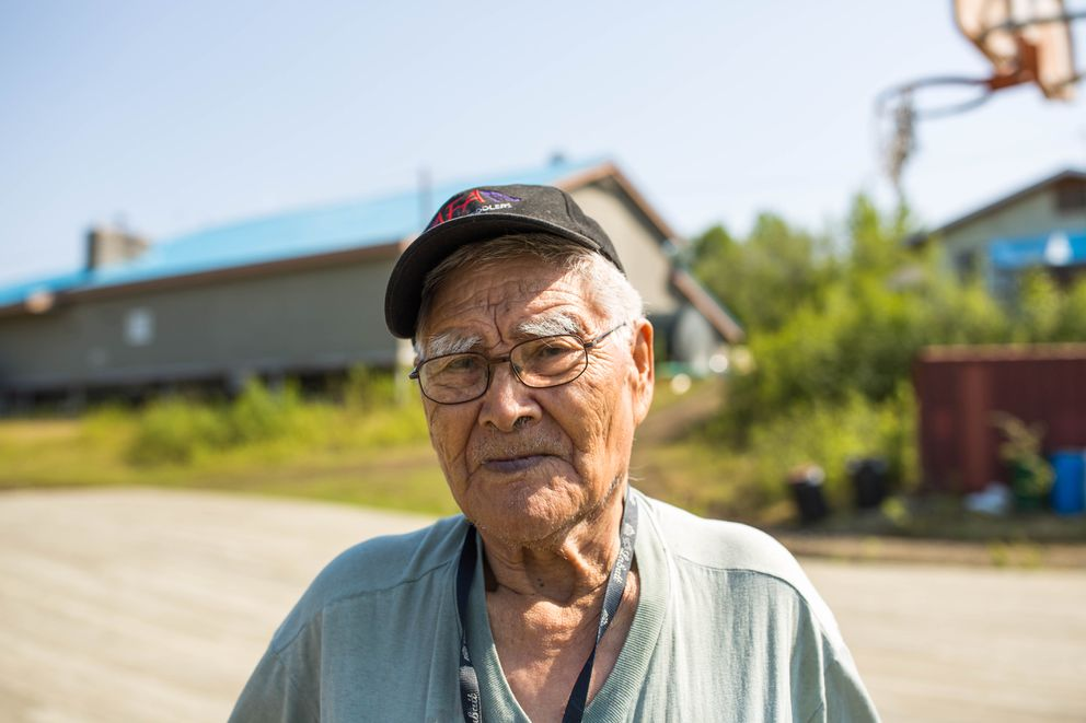 Raymond Dutchman, 91, the oldest resident of Shageluk, takes a break from his daily walk at the village basketball court on May 26, 2016. He says he can't remember any stories of his relatives hunting bison, but he looks forward to being able to do that in a few years when the herd grows to a sustainable size. (Loren Holmes / Alaska Dispatch News)
