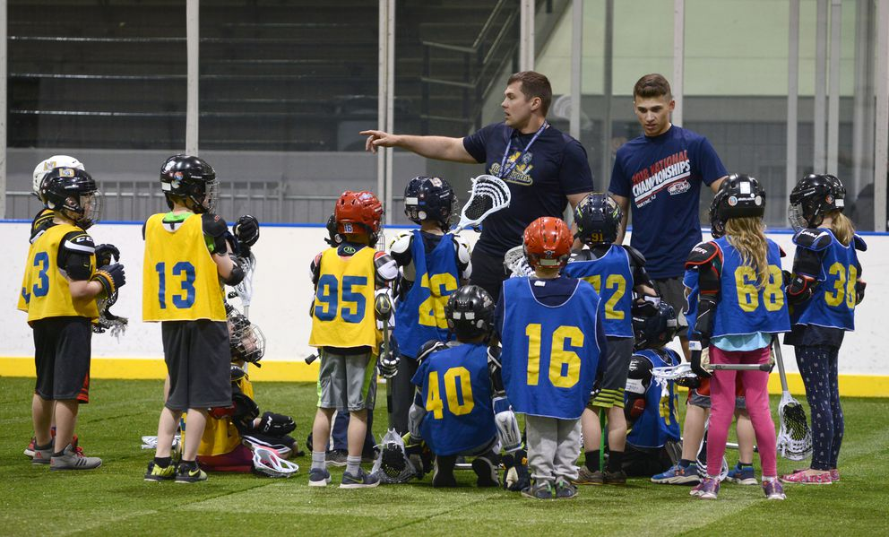 Coach Kirk Kullberg gives directions to the 8U group of lacrosse players.   (Anne Raup / ADN)
