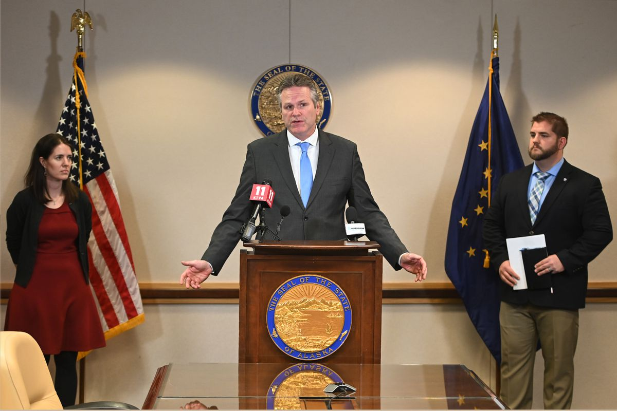Gov. Mike Dunleavy speaks to the media during a coronavirus press conference in his Anchorage office on Monday, March 2, 2020. Gov. Dunleavy is flanked by Dr. Anne Zink, Chief Medical Officer for the State of Alaska, left, and Commissioner Adam Crum, Alaska Department of Health and Social Services. (Bill Roth / ADN)