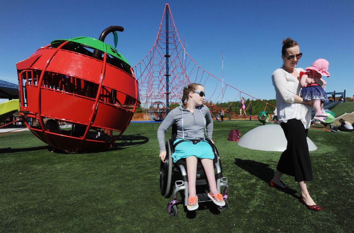 Anna Boltz, 11, visits the playground at the South Anchorage Sports Park with her mother, Leah Boltz, and 4-month-old sister, Adeline. (Bill Roth / ADN)