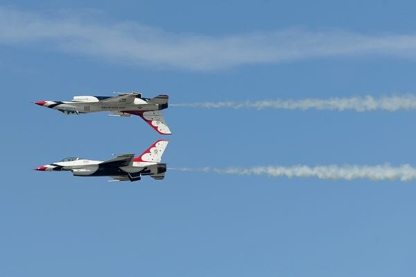 Two F-16C Fighting Falcon jets flown by the U.S. Air Force Thunderbirds make a pass by the crowd during the 2018 Arctic Thunder Airshow at Joint Base Elmendorf-Richardson in Anchorage, AK on Saturday June 30, 2018. (Bob Hallinen / ADN)
