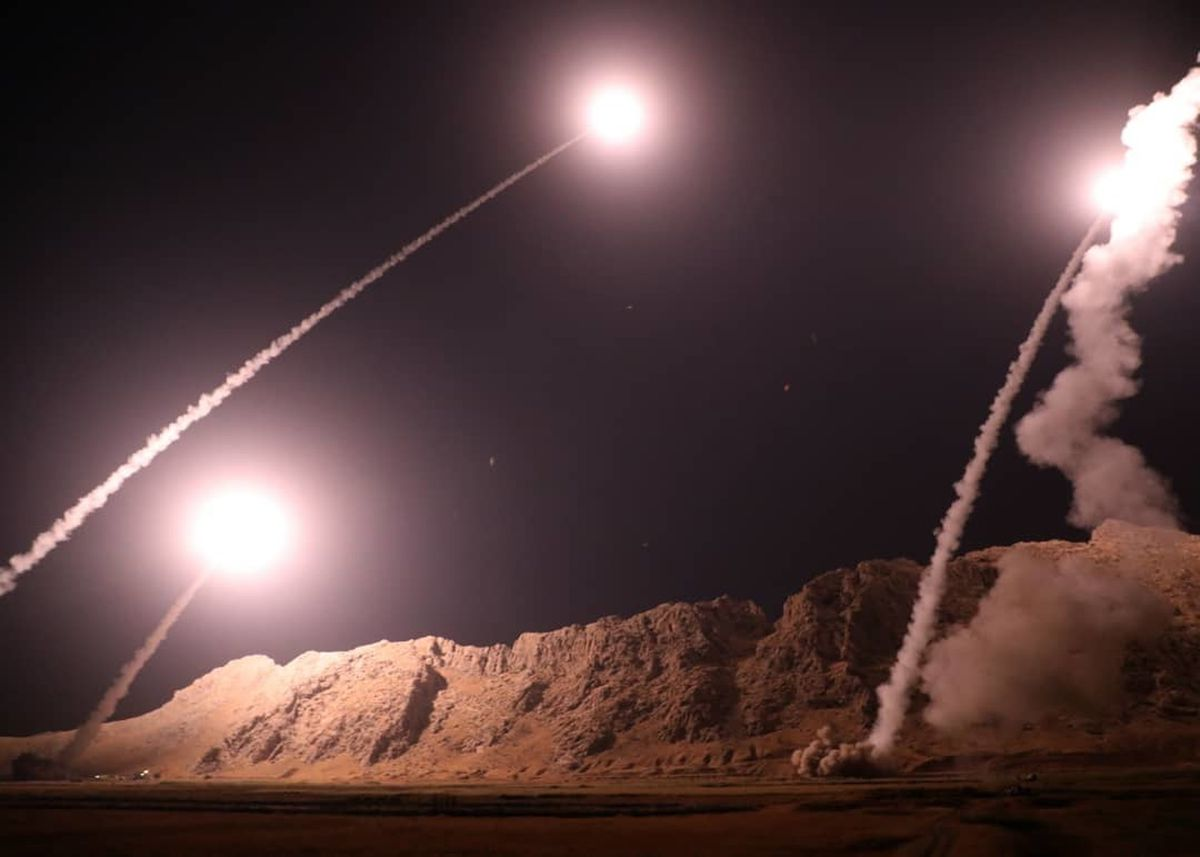 FILE - In this file photo released on Oct. 1, 2018, by the Iranian Revolutionary Guard, missiles are fired from city of Kermanshah in western Iran targeting the Islamic State group in Syria. (Sepahnews via AP, File)